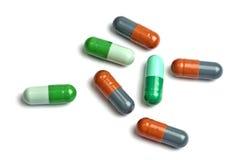 capsules цветасто немногая изолированная белизна Стоковая Фотография RF