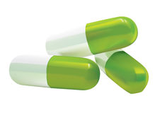 Capsules. 3D illustration of white and green capsules Royalty Free Stock Images