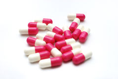 Capsules. Group of white and pink capsules Stock Photo