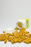 Capsules. Herbal supplement capsules on white background Stock Photos