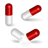 Capsules. Red capsules isolated on white Royalty Free Stock Photos