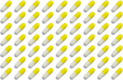 Capsules arranged in row - pills pattern Royalty Free Stock Images