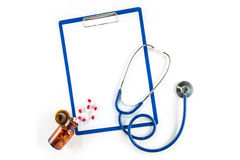 Capsules and bottle with clipboard and stethoscope cardiology Stock Photography