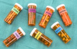 Capsules bottles with indication of days of the week, palliative care in hospital. Conceptual image, horizontal composition stock photography