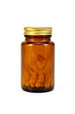 Capsules in a brown jar Royalty Free Stock Images
