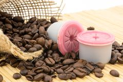 Capsules and coffee beans Stock Image