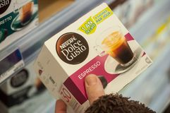 Capsules of coffee doses in hand from dolce gusto brand of Nestle company at Cora Supermarket. Mulhouse - France - 26 February 2018 - closeup of capsules of stock photos
