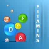 Capsules colorées avec des vitamines Photographie stock