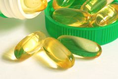 Capsules dietary supplement. On the background Royalty Free Stock Photography