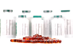 Capsules of dietary supplements and containers. Composition with containers of dietary supplements and capsules Royalty Free Stock Photos