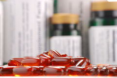 Capsules of dietary supplements and containers Stock Photos