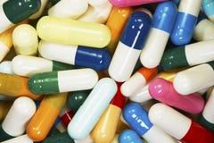 Capsules of different colors. Medicine capsules of different colors and sizes Stock Photo