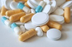 Capsules and drug tablets on white background Stock Photo