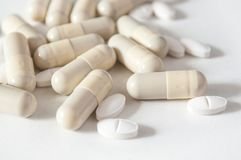 Capsules and drug tablets on white background Stock Images