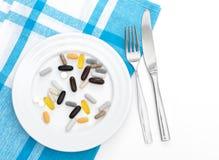 Capsules du plat blanc Image libre de droits