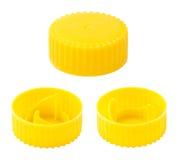 Capsules en plastique jaunes d'isolement Photo stock