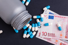 Capsules and European currency Royalty Free Stock Images