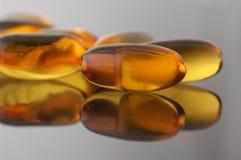 Capsules of fish oil Stock Photos