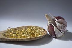 Capsules of garlic oil Stock Photos
