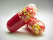 capsules gray över red Royaltyfri Foto
