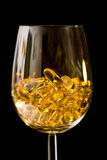 Capsules In The Wine Glass Stock Photo