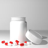 Capsules and jar Stock Photography