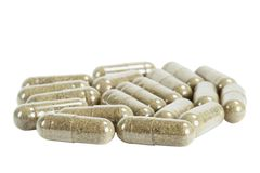 Capsules with medicinal herb Royalty Free Stock Photos
