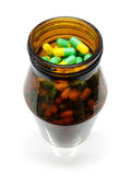 Capsules and Medicine Bottle, Yellow Green Pills Stock Photography