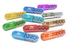 Capsules with Mn, Ca, K, Se, Zn, Cu, Fe, Mg, I, Na element dieta Stock Photography