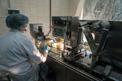 Capsules in packaging process. St. Petersburg, Russia - December 6, 2016: chemical and biological association with the Academy of Sciences for the production of stock photos