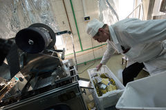 Capsules in packaging process. St. Petersburg, Russia - December 6, 2016: chemical and biological association with the Academy of Sciences for the production of stock images