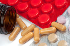 Capsules and pills with bottle clouseup Stock Photo