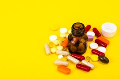 Capsules, pills on yellow background. Concept of health and pharmacology. Studio Photo Royalty Free Stock Photography