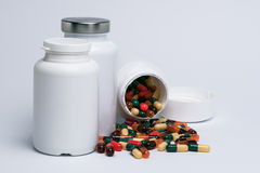 Capsules and plastic bottles Royalty Free Stock Photography