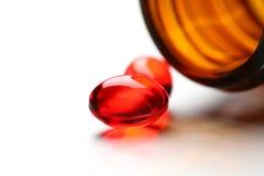 capsules red Royaltyfri Fotografi