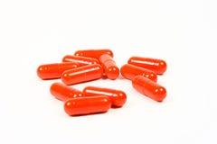 capsules red Royaltyfria Foton