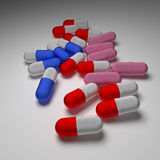 Capsules. Red and blue and pink capsules on white background Stock Image
