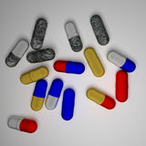 Capsules. Red and blue and yellow capsules on white background Royalty Free Stock Photo