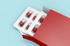 Capsules in red box Stock Photo