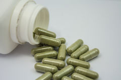 Capsules spilling out of a bottle. Herbal capsules spilling out of a bottle Stock Photo
