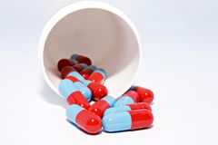 Capsules spilling from prescription bottle Stock Photos