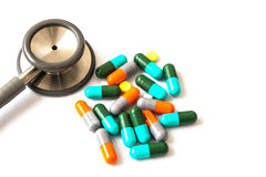 Capsules and Stethoscope Stock Images