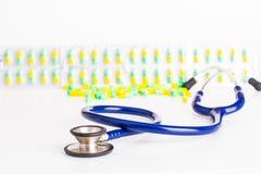 Capsules, stethoscope Royalty Free Stock Photos
