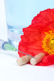 Capsules and syringe Royalty Free Stock Images