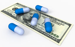 Capsules of tablets on money. Medicine concepts Royalty Free Stock Photo