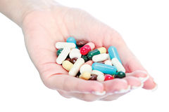 Capsules in woman's hand Royalty Free Stock Images