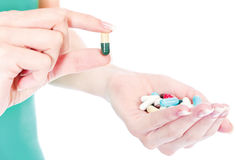 Capsules in woman's hand Royalty Free Stock Image