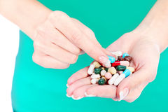 Capsules in woman's hand Royalty Free Stock Photography