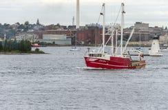 Capt för skyttel för kommersiellt fiske Jesse övergående fyr royaltyfri fotografi