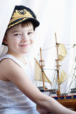Captain. Portrait of the young boy with the model ship Stock Image